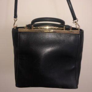 Black and gold Michael Kors hand bag